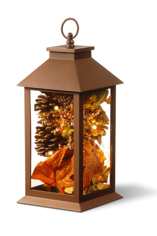 Decorative bronze lantern filled with pinecones, fall leaves and LED lights.