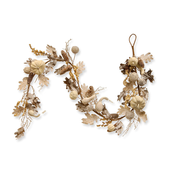 Fall decorative garland with white and tan pumpkins, leaves and pinecones.