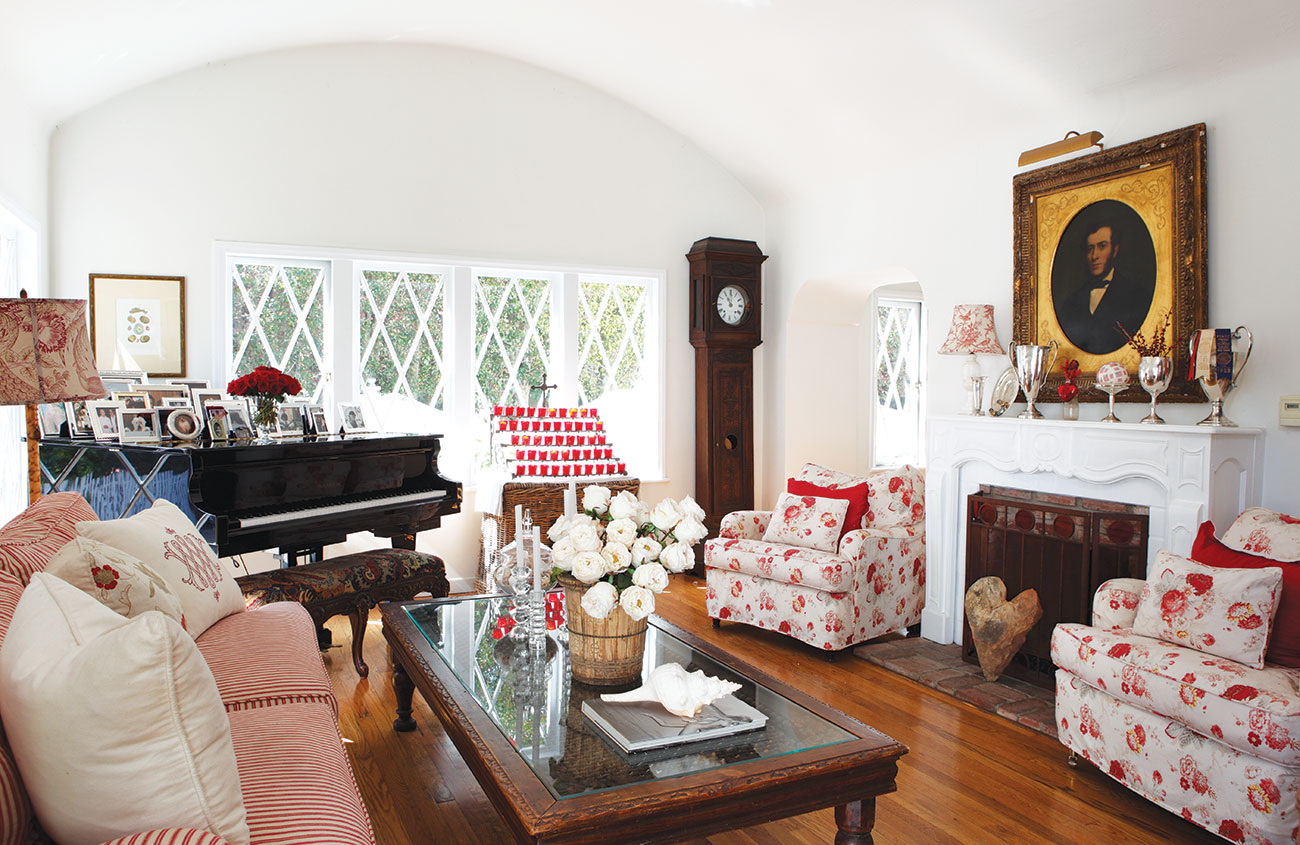 English Country Style living room complete with grandfather clock, piano and red accented furniture.