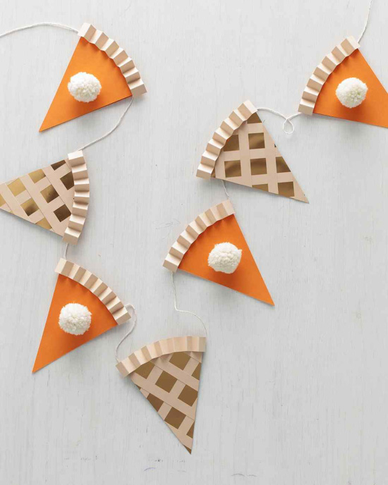 Pieces of pie made out of paper and attached by string to create a garland.