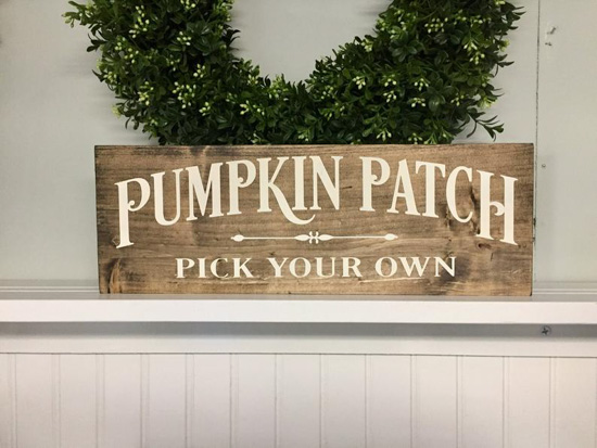 "Farmhouse Halloween decor, wooden sign with white writing that says ""pumpkin patch pick your own""."