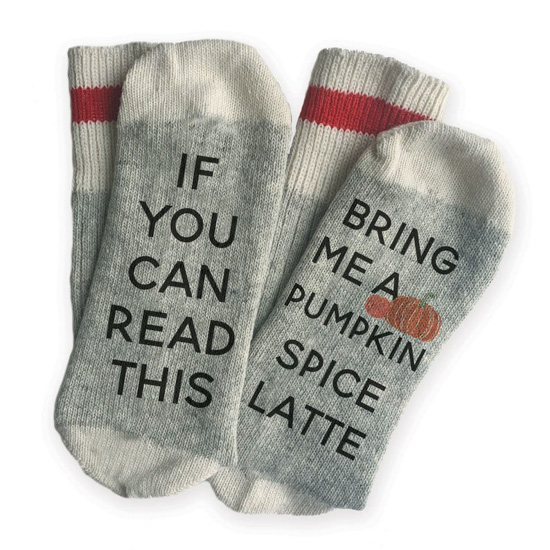 Thick socks in gray and white with a red stripe around the calf that read across the bottom of the feet, 'if you can read this bring me a pumpkin spice latte.