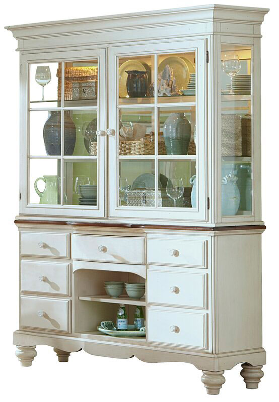 White china cabinet with plates and dishes inside.
