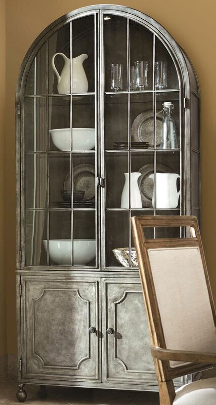 Gary toned china cabinet with white plates on display.