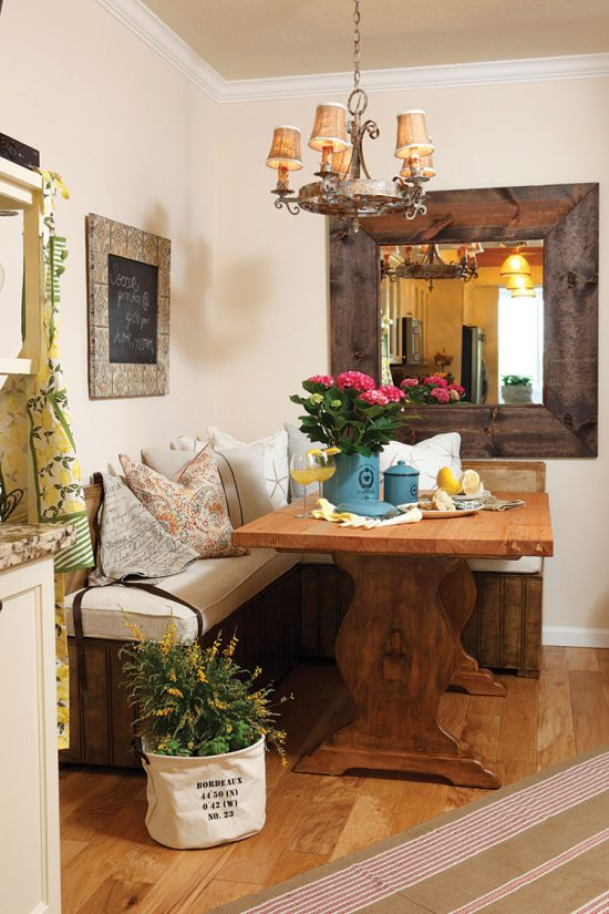 Country style banquette dining area and placed with fresh flowers.