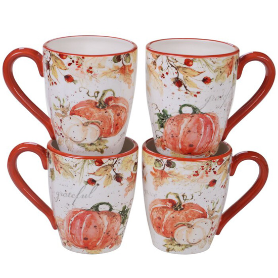Set of 4 ceramic fall mugs with bright orange-red handles and covered in watercolored pumpkins and fall leaves.