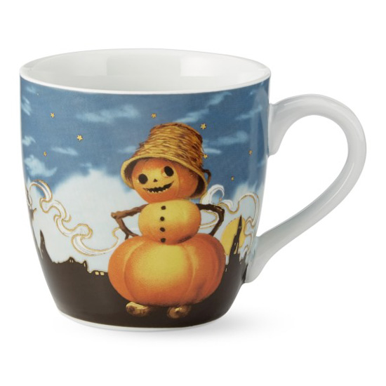 White porcelain fall mug with vintage image of a fall snowman made of pumpkins with a silhouetted city in the background.