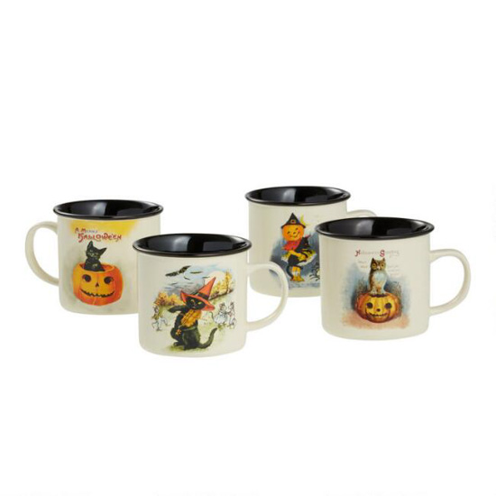 Set of 4 vintage halloween mugs white on the outside and black on the inside each with a different themed design.