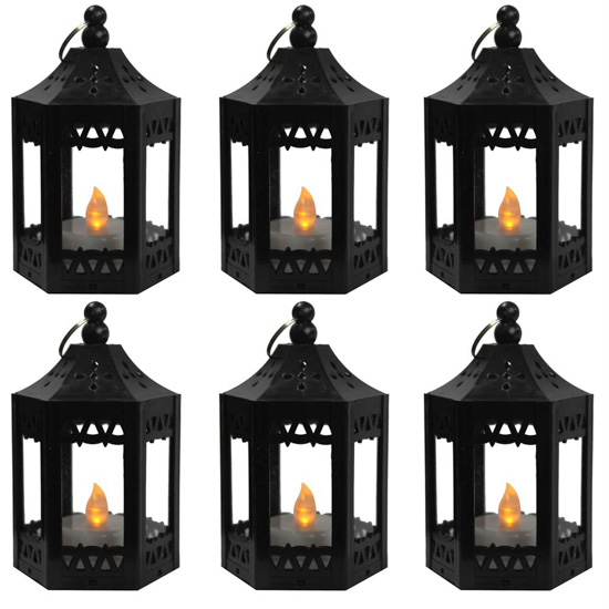 Set of 6 mini lanterns with flickering battery operated candles inside.