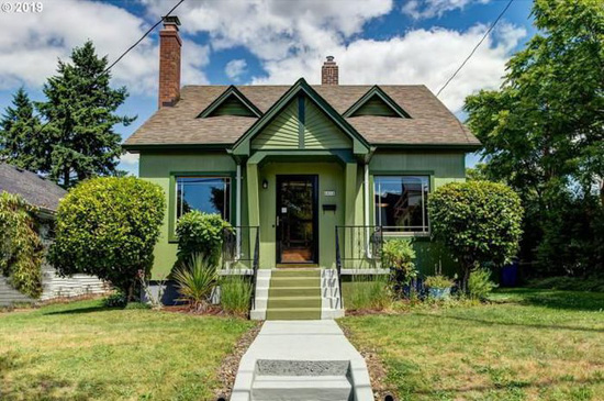 Cement steps and walkway to qa storybook style cottage with green and dark green accents in Portland, Oregon.