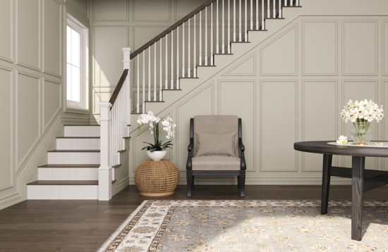 Dark toned hardwood floors leading to a staircase displaying fresh white stair risers that bend up towards the second story from the entryway.