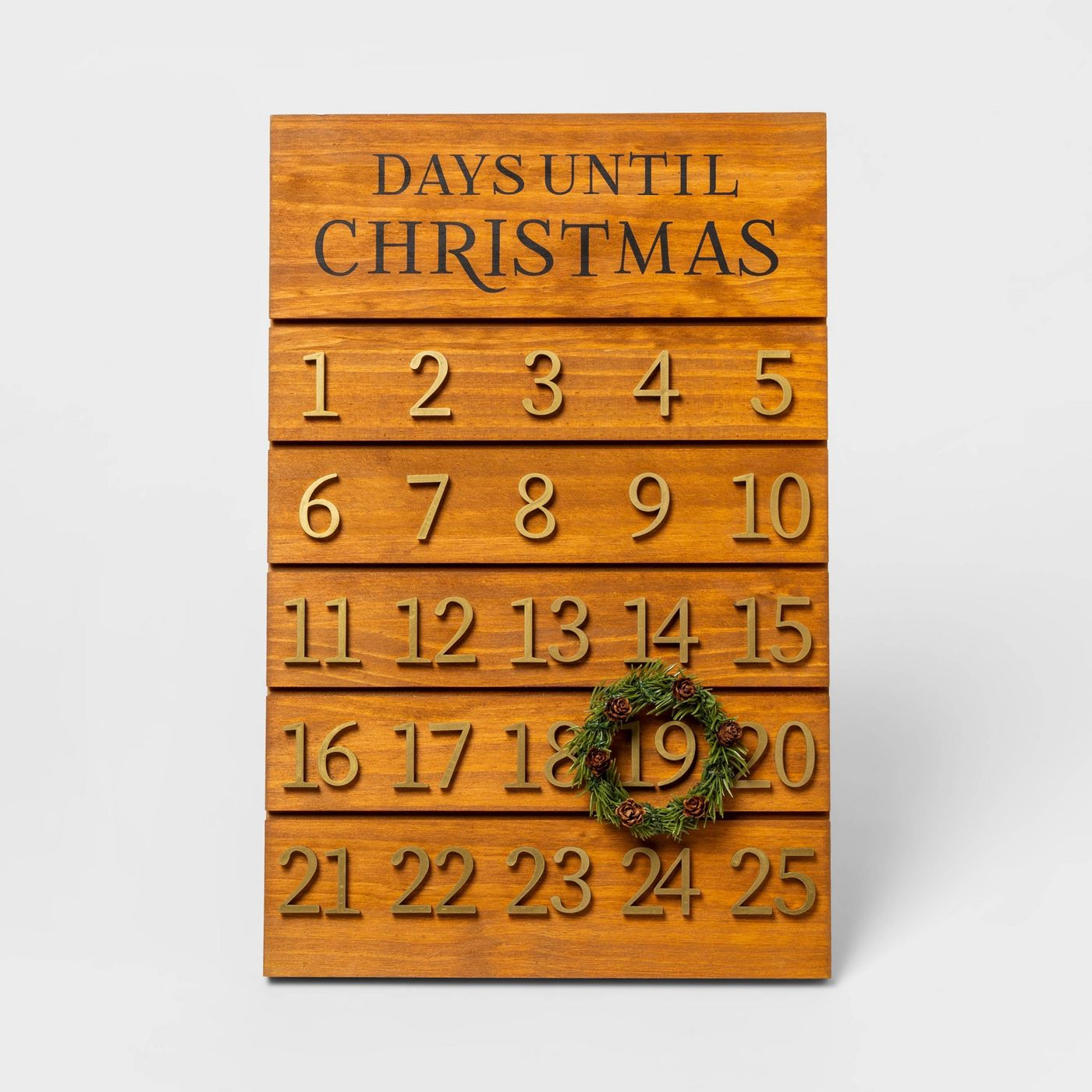 Wooden advent board with a small wreath to encircle the day of the month.