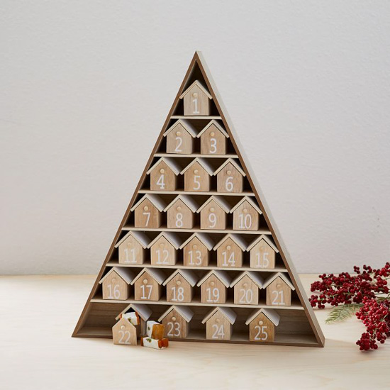 Wooden triangular, tree shaped advent calendar filled with tiny openable house numbered to 25.