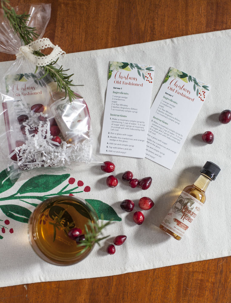 christmas old fashioned recipe favor bag with fresh rosemary, rye whisky and cranberries