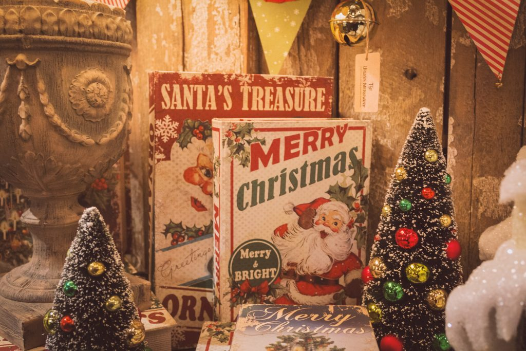 vintage santa sign and retro style christmas decor on display at a vintage market