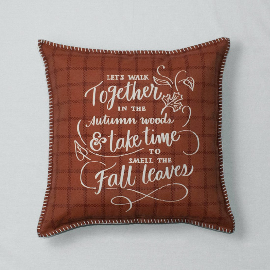 Auburn colored throw pillow with a fall quote written on one side in white.