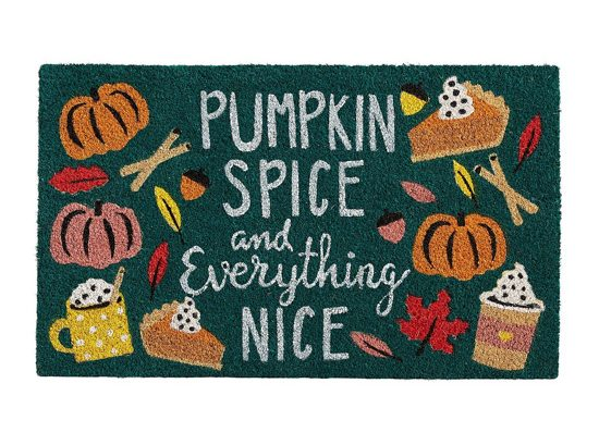 """Green front doormat that says """"pumpkin spice and everything nice"""" surrounded by drawings of pumpkins, cocoa filled mugs and slices of pumpkin pie."""