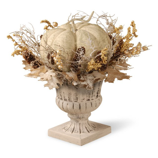 White and beige topiary filled with foliage and matching pumpkin.