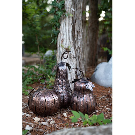 Set of three metallic luminaries in different shapes and sizes of gourds.
