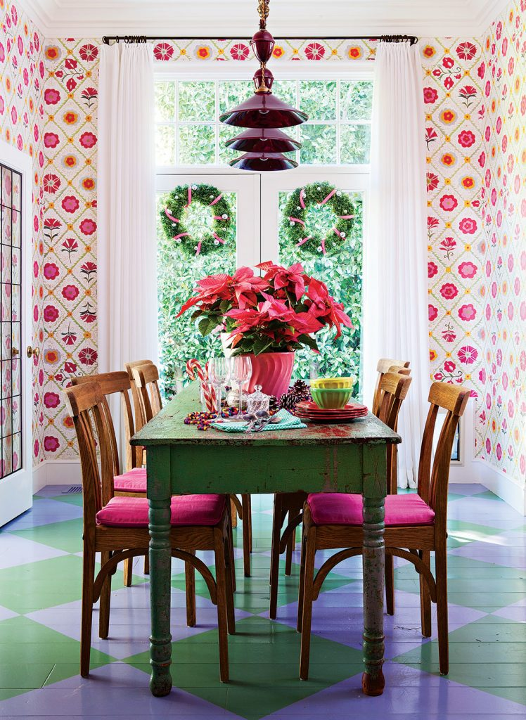 dining room with floral pattern wallpaper, painted check floors and a vintage dining table