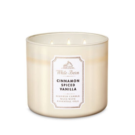 White wax, triple wick candle in frosted glass smelling like cinnamon spiced vanilla.
