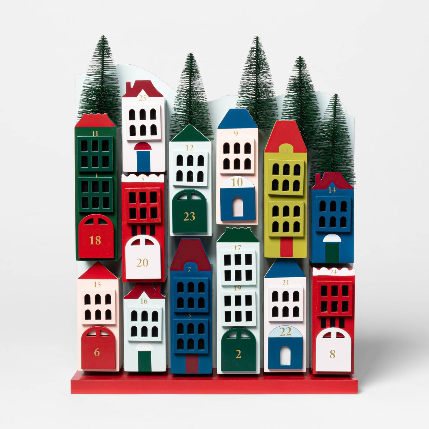 Wooden Advent Christmas village with decorative bottlebrush trees lining the top.