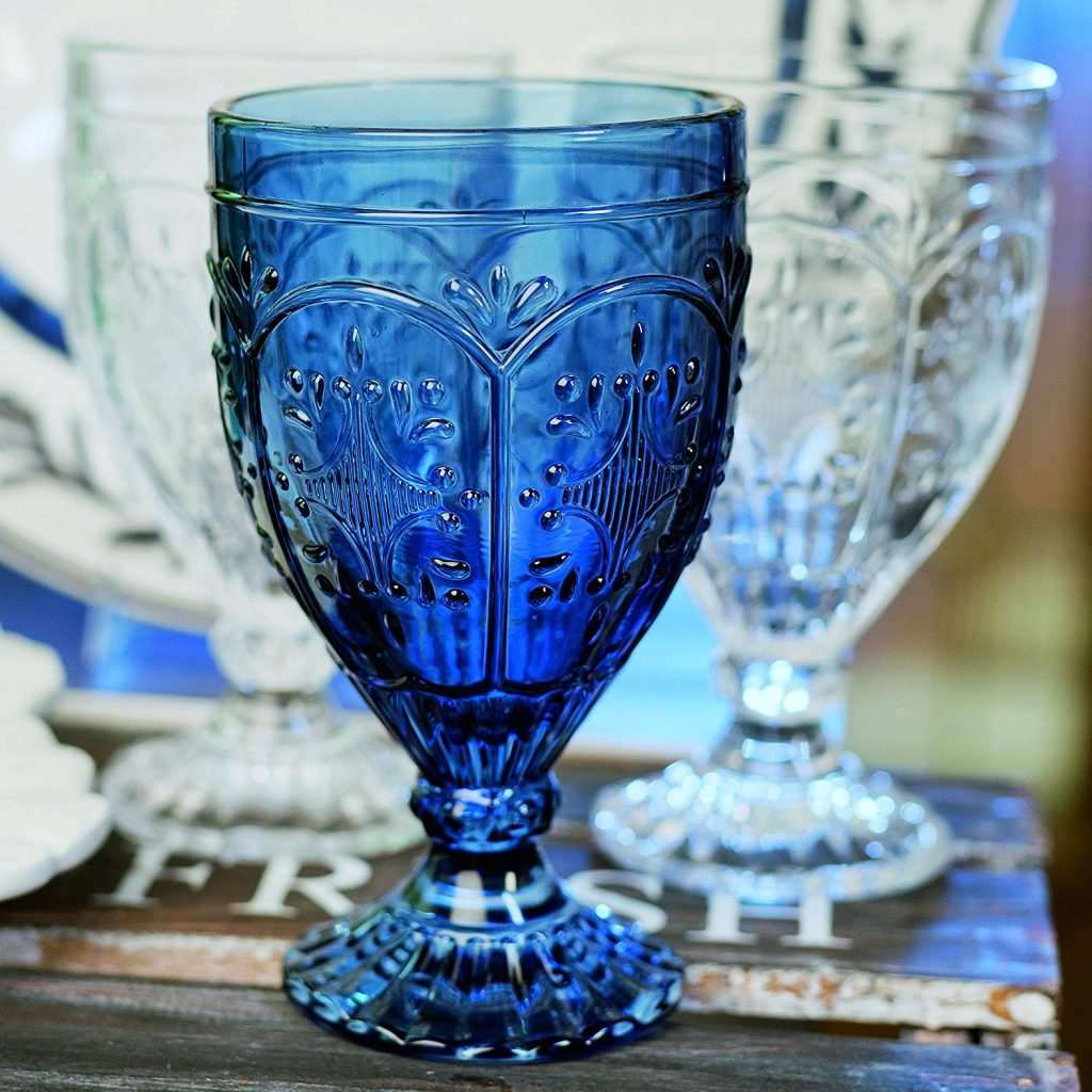 Blue glass goblet with lighter glass goblets in the background.