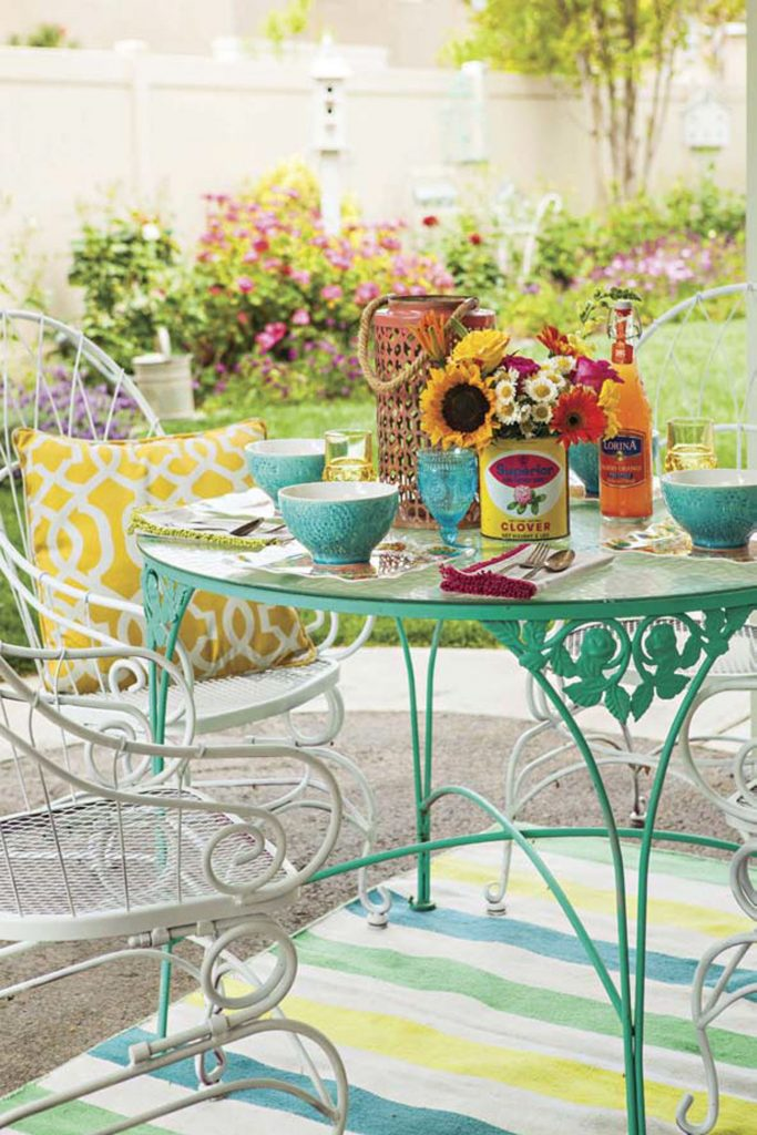 Wrought iron patio dining set topped with a brunch spread.