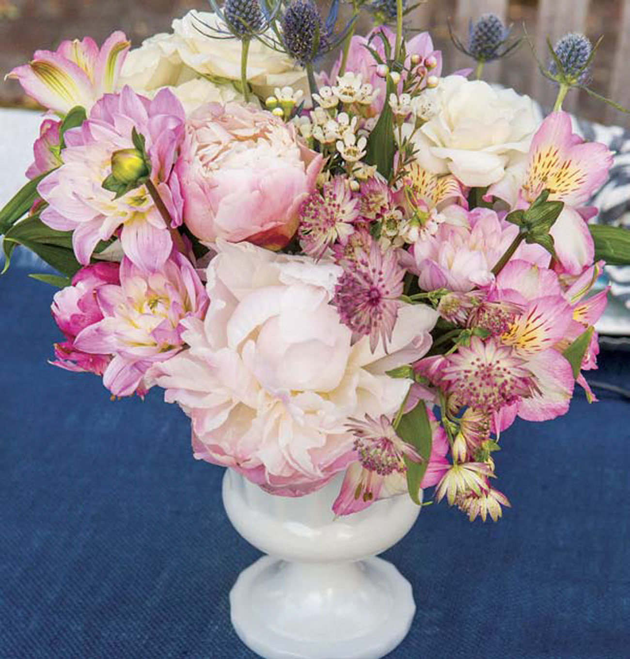 Peonies, dahlias, alstroemeria, Scottish thistles, roses and wax flowers combine for a tone-on-tone arrangement