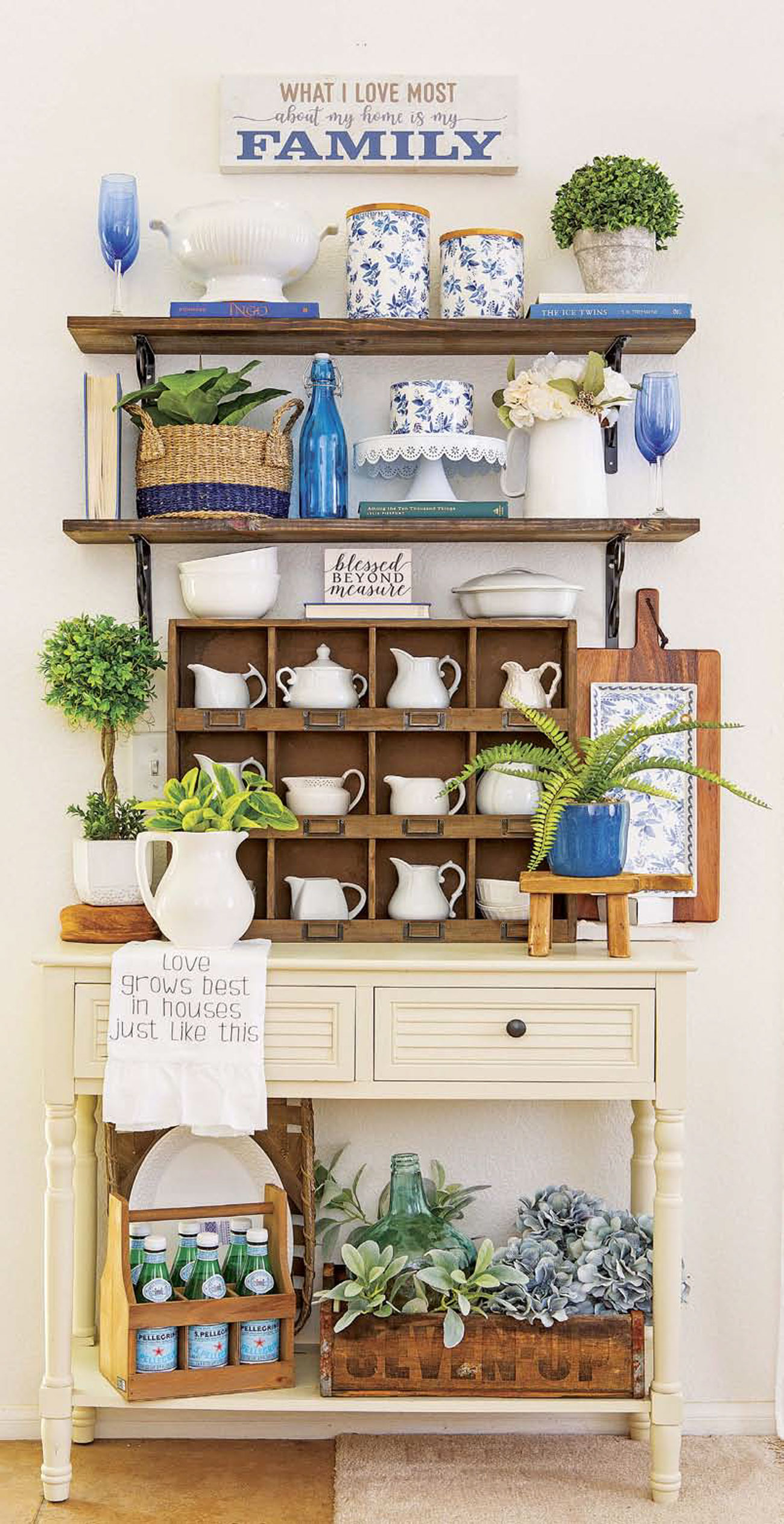 Wooden shelving and a vintage cubby cabinet filled with white cream-and-sugar sets and pops of blue and green.