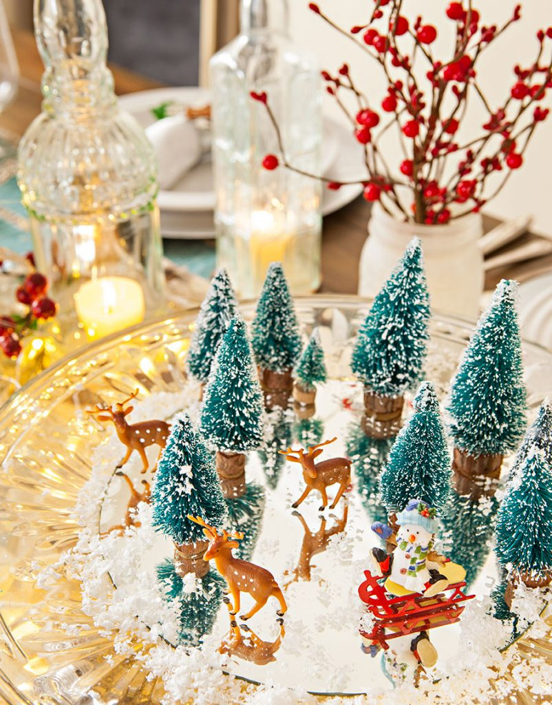 christmas vignette of mini bottle brush trees and deer on a crystal cakeplate