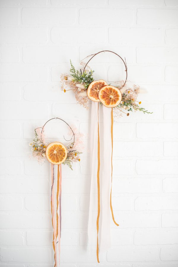 mini wreath decorated with dried flowers and citrus