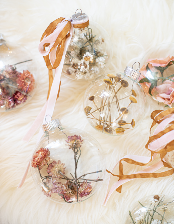 clear christmas tree ornaments filled with dried flowers