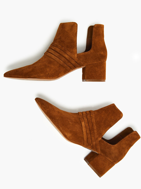 Tobacco colored suede booties with unique detailing and side cutouts.