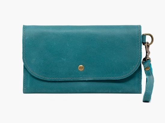 Teal leather small wallet with gold button and wrist strap.