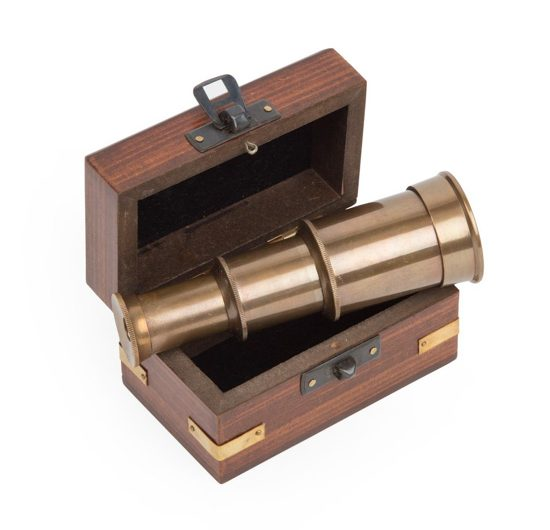 Small wooden box with metal accents that stores an extendable mini telescope.