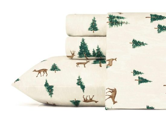 Cream colored flannel sheet set with roaming deer and pine trees.