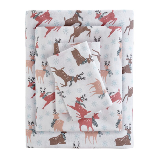 Stack of white flannel sheets covered in muted colored coral, brown and peach reindeers wearing scarves and prancing around.