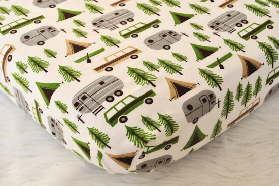 Camping themed fitted flannel crib sheet.