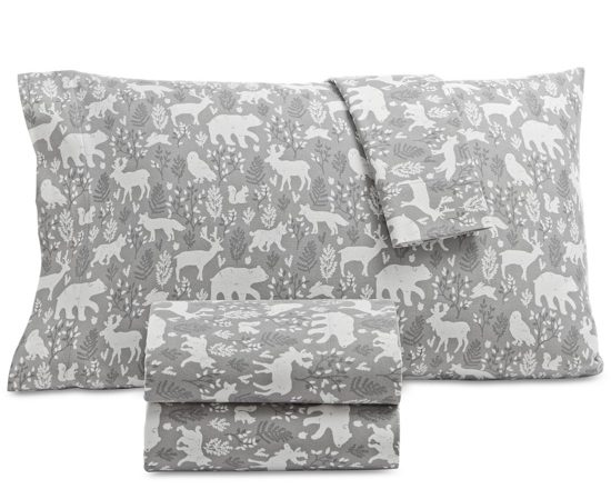 Gray flannel sheets covered in white woodland silhouettes.