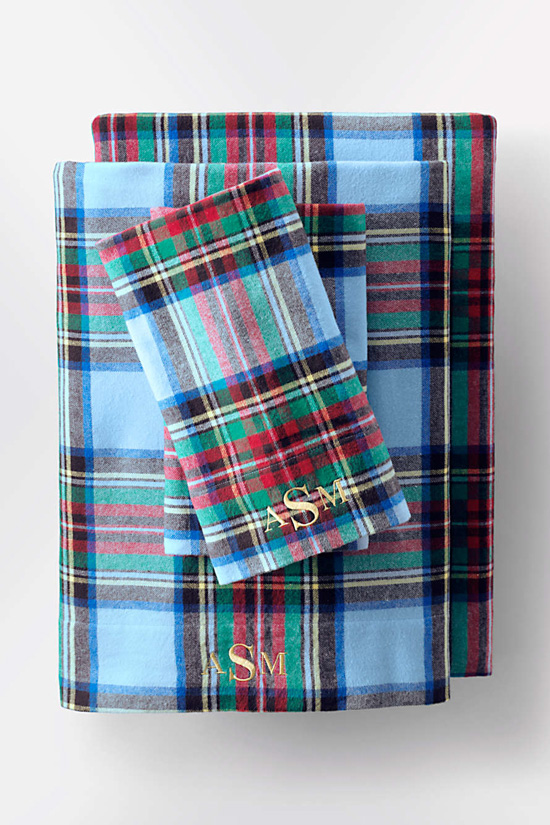 Christmas themed plaid flannel sheets with monogramming.
