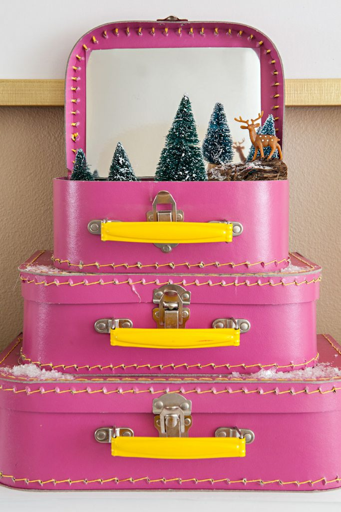a holiday vignette in mini pink suitcases