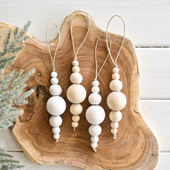 Wooden dissection topped with minimalist wooden bead ornaments.