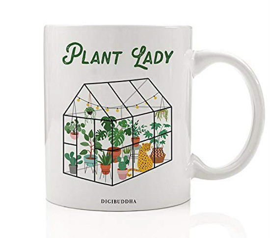 "White ceramic mug with green house and ""plant lady"" decorated on one side."