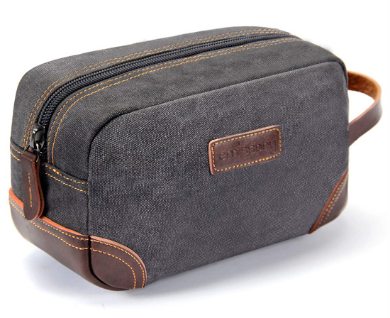Grey canvas toiletries bag with brown leather accents.