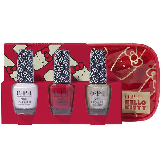 Decorative holiday box filled with three Hello Kitty themed nail polishes.