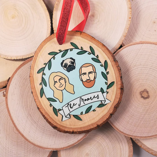 Personalized, hand-painted ornament with a small family painted on the front of a small wooden piece.