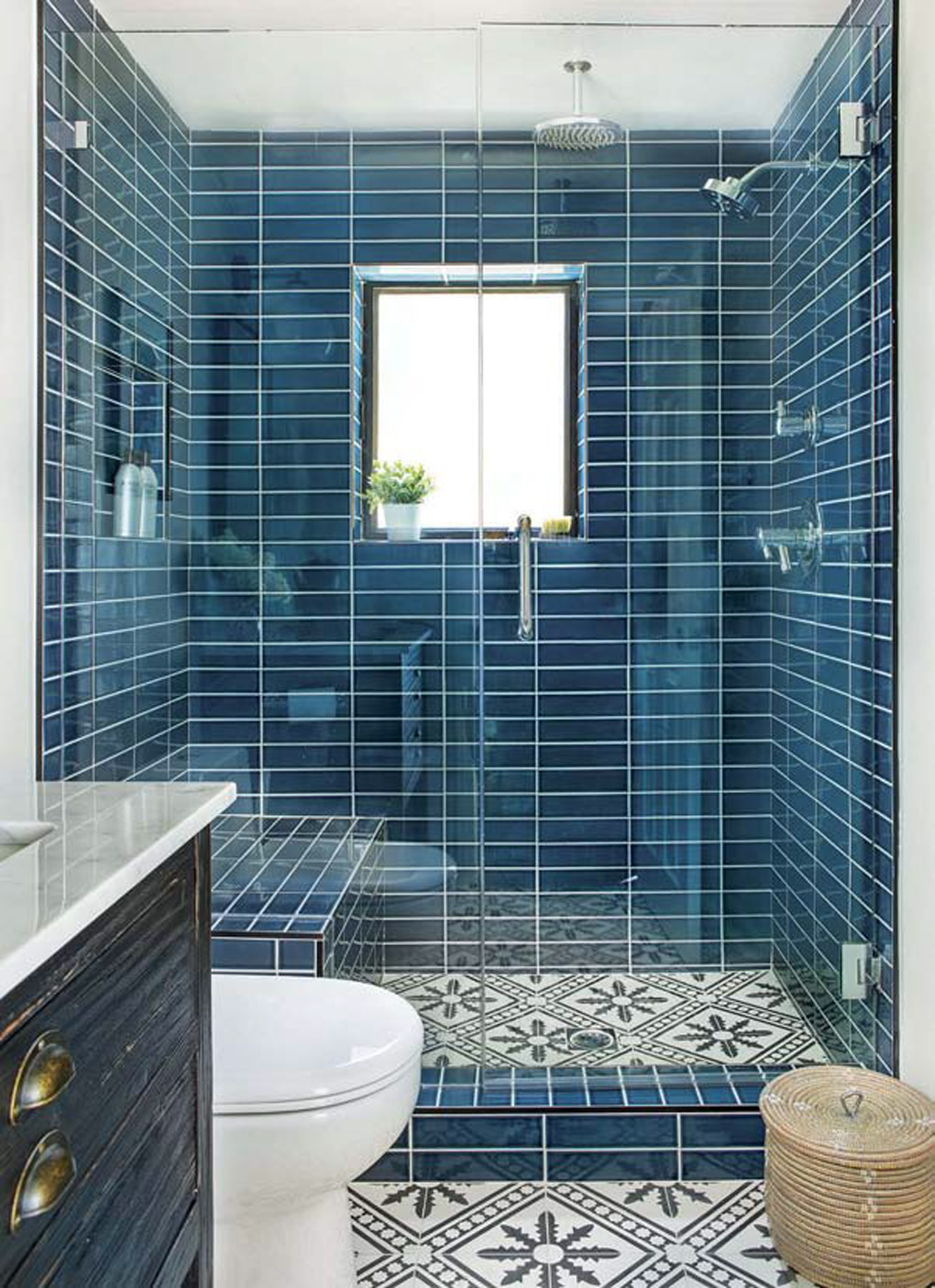 California cottage with a brightly lit large shower fully tiled in teal rectangle tiles with ornate flooring.