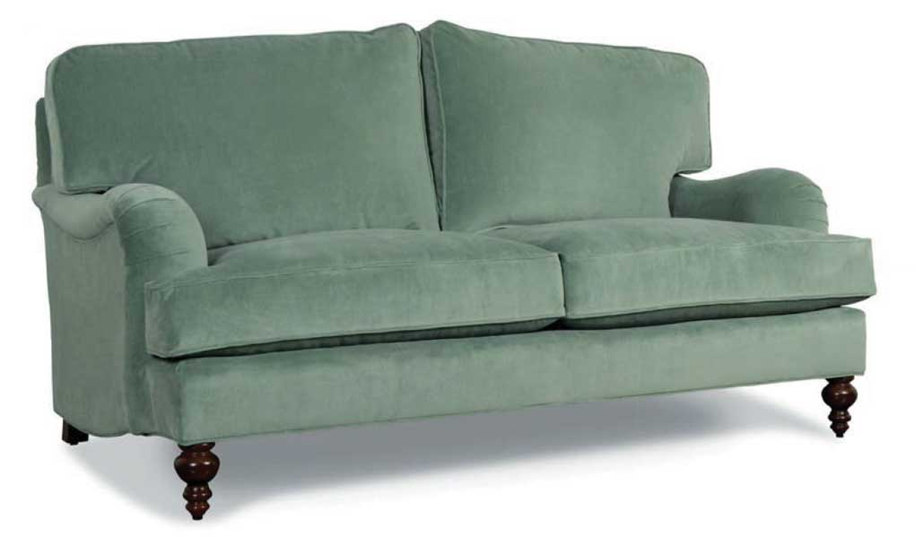Seafood green rolled arm loveseat with wooden turned feet.