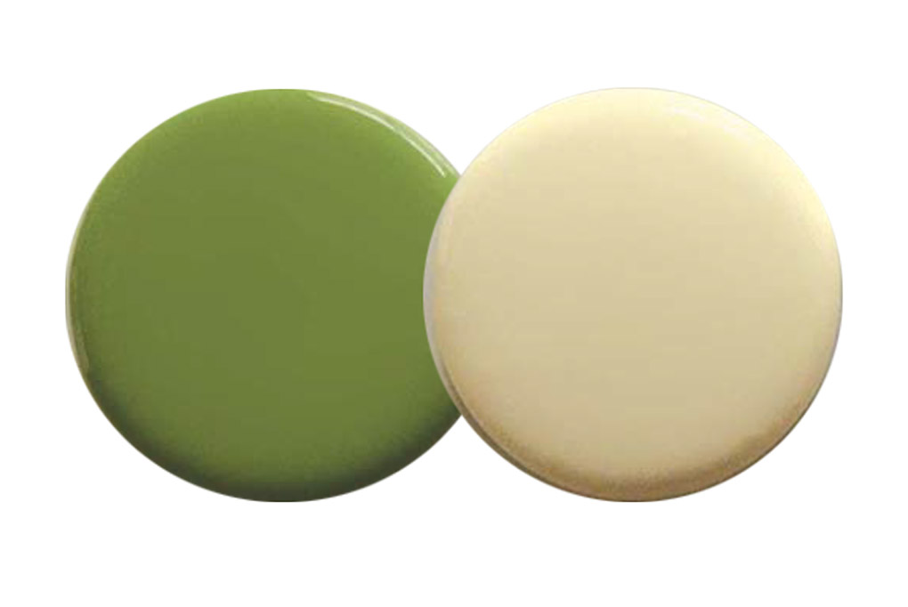 Two paint spots in buttercream and green.